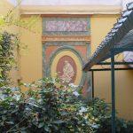 Décor mural du jardin d'un élément décoratif en marqueterie de faux marbre et patine à 2 tons